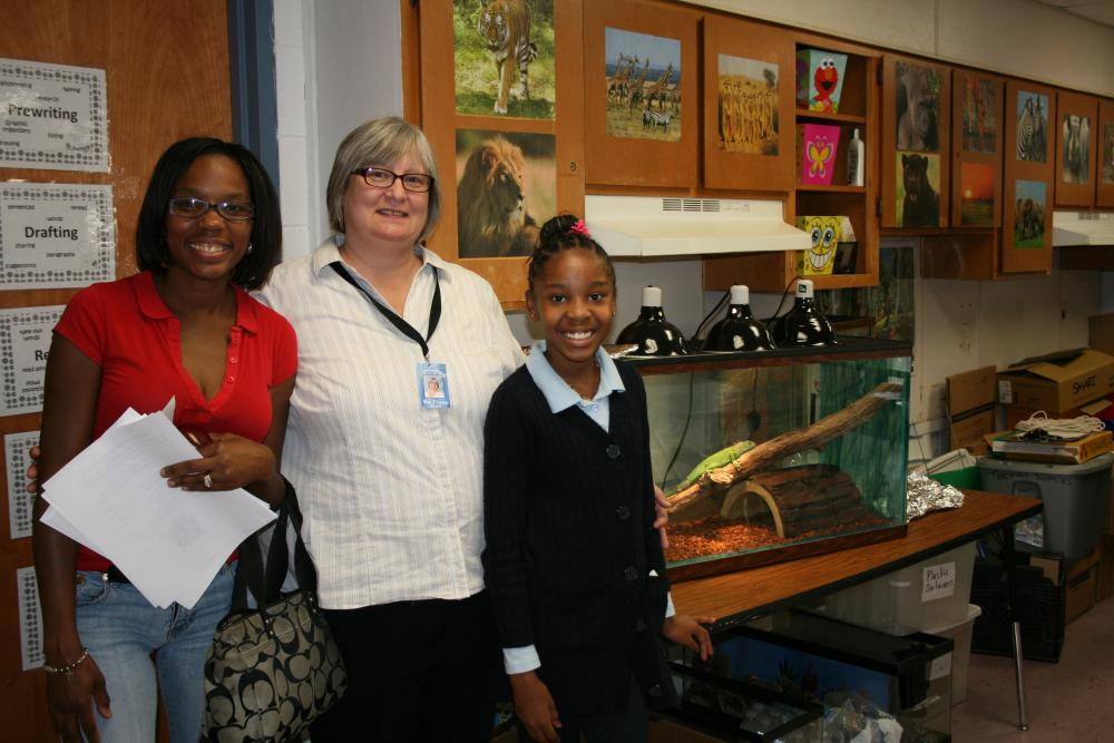 A Greater Heights Academy teacher with students